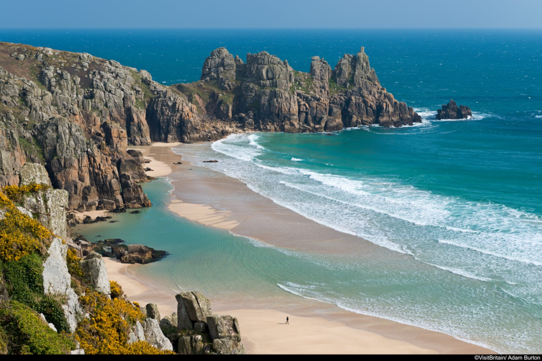 Beautiful Pednvounder Beach, backed by the Logan Rock, Cornwall.