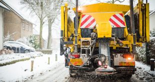 Winter gritting lorry at work