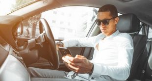 Young driver using mobile phone